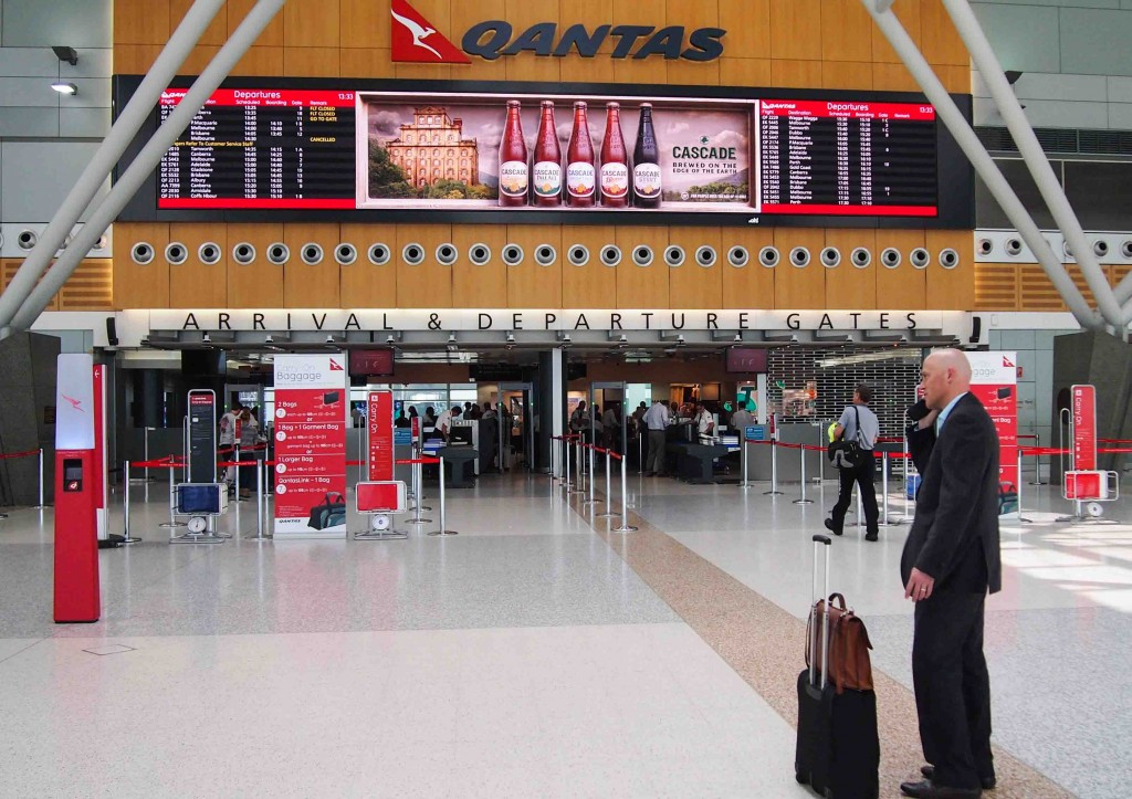 Qantas Terminal 3 Sydney Australia - Large scale hi-resolution LED display integrated with Flight Information either side